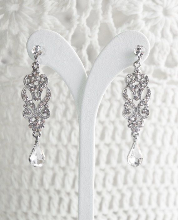 Eye-catching rhinestone-embellished earrings can be used special occasions as bridesmaid jewelry etc.   We have many option as bridal or bridesmaid jewelry, check it out!  The length of the earrings is about: 5.8 cm.   https://www.etsy.com/shop/ShinyBridal?ref=l2-shopheader-name§ion_id=19089005  & Made in Turkey &  Thanks for visit my shop