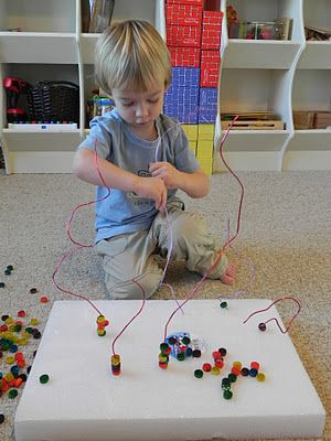 I have done this activity before and the kids love it! You just need a Styrofoam base, flower wire, and colored beads or pasta. This will keep you kid busy for awhile.