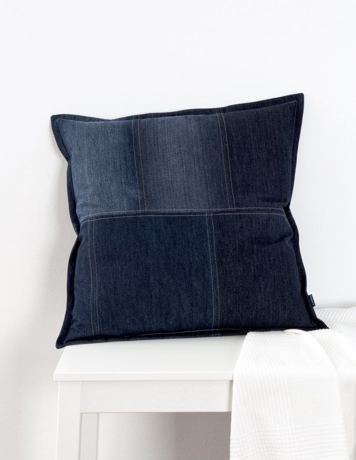 The Minimalist cushion by JEANBAG is made from 100% cotton recycled denim jeans. It's clean lines, tailored stitching and beautiful patina give it class.