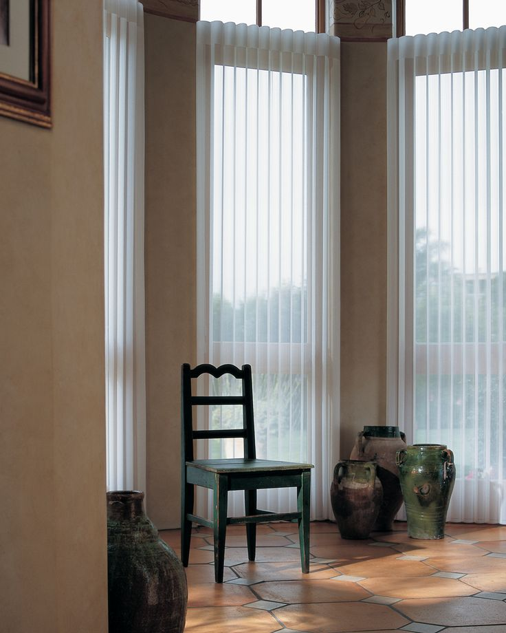 Bretz Interiors, a Denver area Hunter Douglas Gallery showroom, provides sheer Luminette drapery window shades for all your window covering needs.