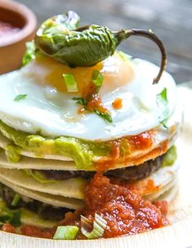 Guacamole Breakfast Stacks are AWESOME. Layers of tortilla, black beans, guacamole & salsa topped with a fried egg and a roasted jalapeno! Easy and delicious!!