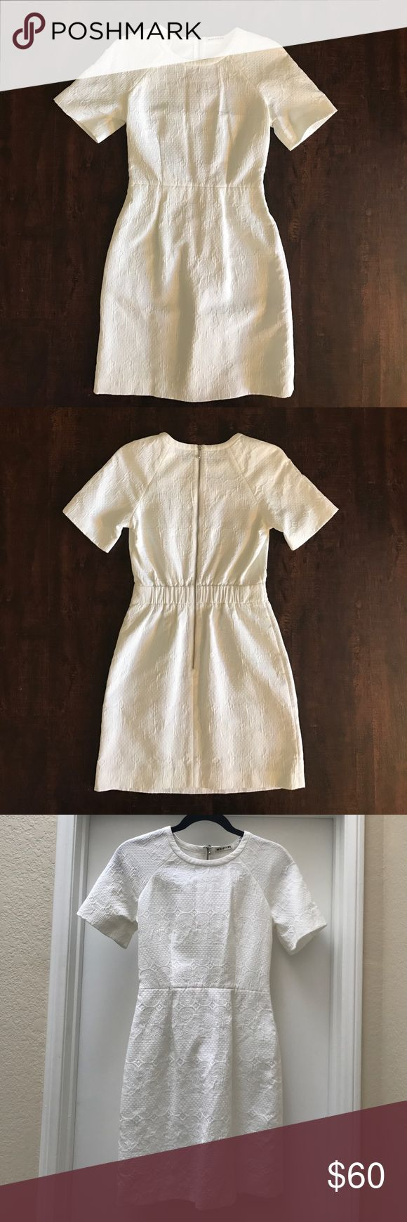 Beautiful white WHISTLES dress size 2. Beautiful white Whistles dress with amazing details in the fabric (close up picture provided). This dress would be perfect for a bridal shower or any spring/ summer event! Whistles Dresses Mini