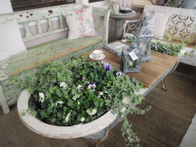 An old tin bathtub turned into a patio coffee table/planter combo.  How cool is this?  Photo taken at Bachman's Spring Idea House 2011 by Carla of Hammers and High Heels.