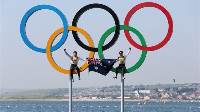 Australia celebrate in the Olympic Rings at Weymouth and Portland