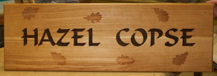 A large oak sign with brown text in the marlin font and