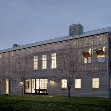 Louver House, Barn Conversion: Location: Wainscott, NY, USA Year of Construction: 2014 Architects: Leroy Street Studio The barn style design affords a large linear interior space to the users that is dressed with a rain screened facade and some operable pieces.