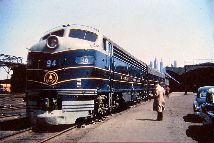 """Baltimore & Ohio E8A #94 awaits departure from Track #1 with what is most likely the southbound """"Royal Blue"""" (New York/Jersey City - Baltimore - Washington) at the Jersey Central's large Jersey City Terminal complex in New Jersey."""