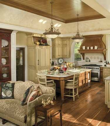 Same French country kitchen - the glass door leads to the pantry and the couch separates off the hearth room.