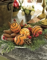Clove-covered oranges, pinecones, berries and greenery make a charming centerpiece. And so easy to assemble! I love making clove oranges. :)