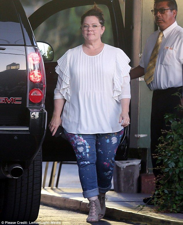 Wearing her line: On Friday, Melissa McCarthy, 45,  was her own best model while on a date with her husband