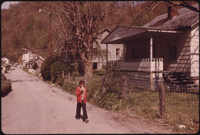 Original Caption: Youngster Returning to School after Going Home During Recess to Get an Ice Cream Cone. The Town of Chattaroy, West Virginia, near Williamson, Is Small Enough So the Youngsters Can Do This. Many of Them Also Go Home for Lunch. The Town Has No Industry, and Most of the People Survive on Welfare, Pensions Social Security and Black Lung Benefits 04/1974  U.S. National Archives' Local Identifier:  412-DA-14002  Photographer:  Corn, Jack, 1929-  Subjects: West Virginia (United…