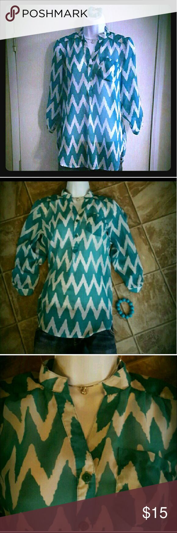 Chevron Shirt Loose Flowy Turquoise Top Chevron Shirt Loose & Flowy. Brand: Rue 21. Tag says small, but could also fit a medium. Never worn.   Smoke free home. I will gladly bundle items to give you a discount! The more you buy, the cheaper I can let everything go!   Chevron Shirt Loose Flowy Turquoise Top Rue 21 Tops Button Down Shirts