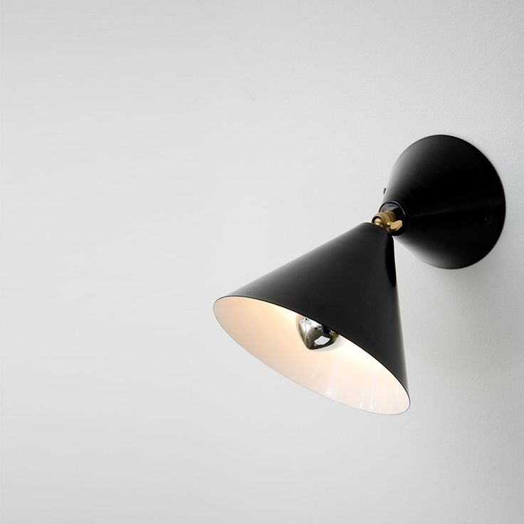 """CONE WALL LIGHT by Atelier Areti. Atelier Areti's focus is on the production of beautiful, useful, well designed products that are made to last (""""Areti"""" means virtue and excellence in Greek). All products are made in an environmentally conscious way by master craftsmen and small manufactures in Germany and Sweden."""