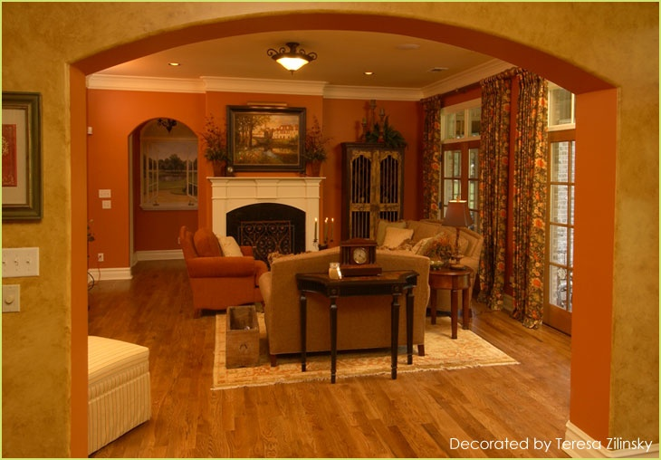 find a kitchen designer pendants living room with warm burnt sienna walls, would definitely ...