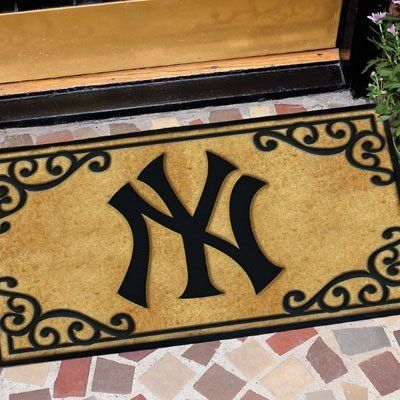 "Memory Company New York Yankees Welcome Mat by MLB. $55.00. Usually ships within 3-5 days. Shipping Times during the holidays may be 1-3 days longer. Logo Door Mat. 24"" length x 39"" wide  Durable coir fiber top  Skid resistant rubber bottom  Team graphic displayed in the center  Officially licensed. Save 23% Off!"