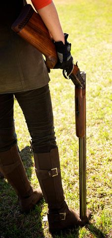 Beautiful Over and Under Shotguns go hand in hand with the world of sporting clays.