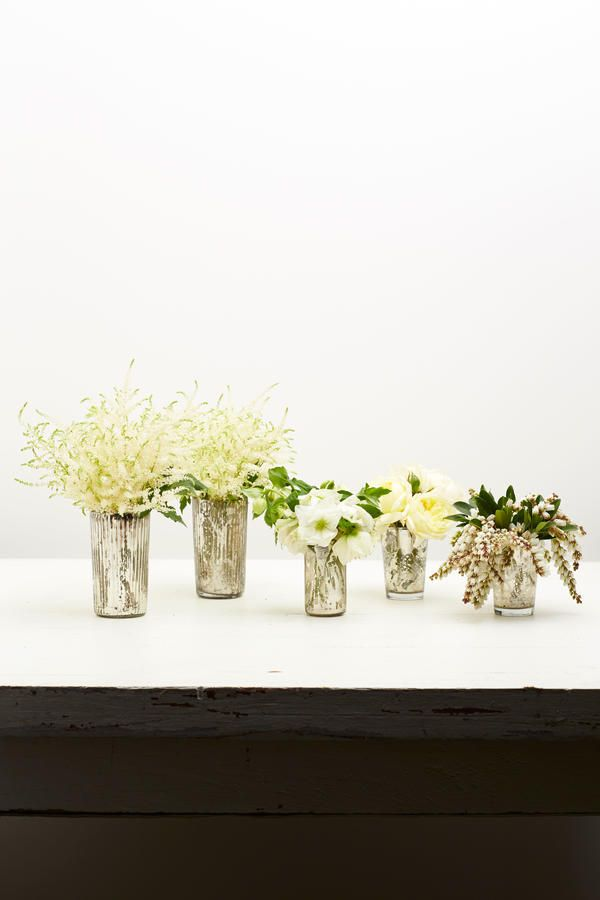 Step 2 - Step-by-Step Holiday Flower Arrangements - Southernliving. Stick to a single flower type in each vase to create a more professional look.