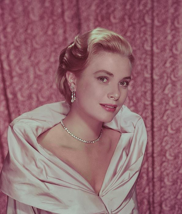 Grace Kelly: Looking as radiant as ever with swept back hair, a flawless complexion, and dazzling statement jewellery.