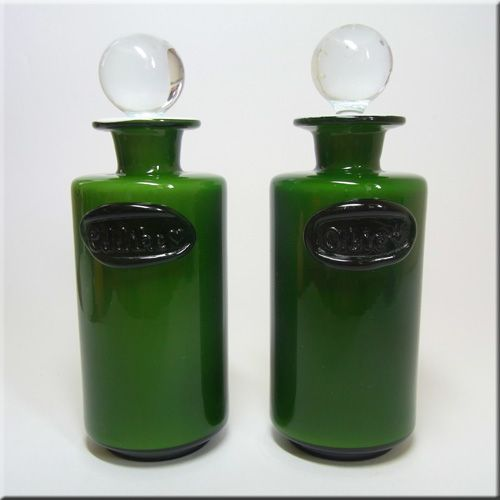 Pair of Holmegaard green glass spice jars from the Palet range, designed by Michael Bang.