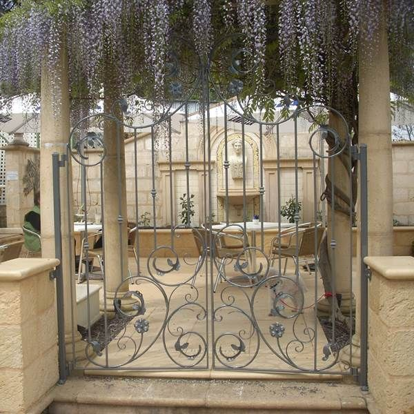 These wrought iron gates sit perfectly in this cafe's terrace.  Newman's Nursery, Adelaide, SA.