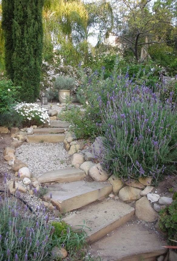 Provence inspired garden - love the lavender spilling over the edges