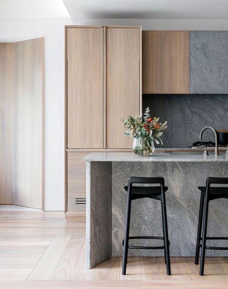 Beautiful kitchen in grey, light oak, and white.