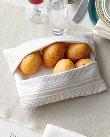 DIY Cloth Napkin Bread Basket by Martha Stewart: Just a few folds! (You could sew one up lickety split too!)
