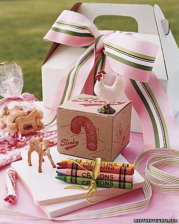 Make a Play Pack: Make up boxes, like these created by Martha Stewart, filled with edible treats, crayons, and small games (like a Slinky) for each kid guest. They'll love feeling like they've received their own present and will be entertained playing with their new goods.   Source: Martha Stewart Weddings