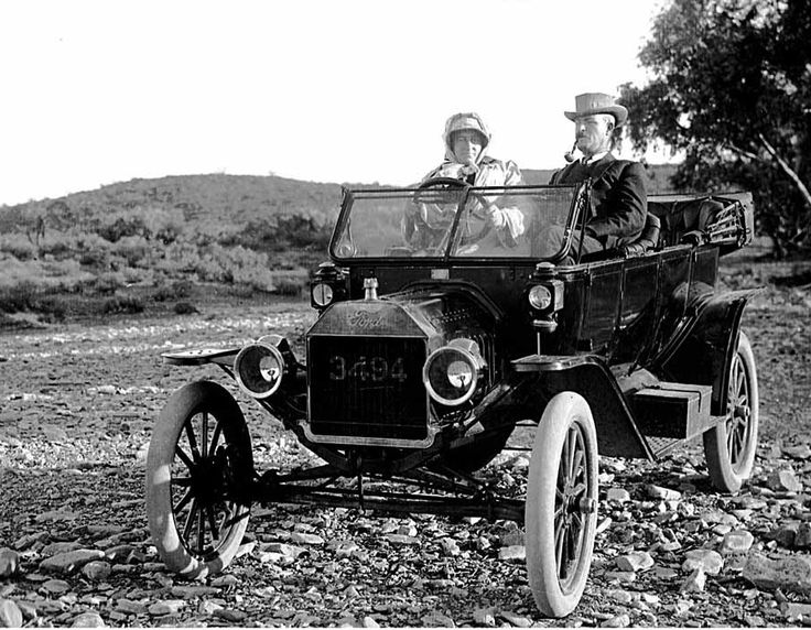 """1913 tourer f budge.  David Chantrell  found a pair of ancient glass plate negatives that were found under the floorboards of the old Farina General Store just prior to it's demolition.  """"Image #1 – is of a 1913 Ford tourer, registered on 1st September 1913 to Mr. F Budge of Farina. He is believed to be the bearded passenger in the slide. The detail is superb. The plate in the centre of the dashboard is from Duncan & Fraser Limited, the sole South Australian Ford distributors."""