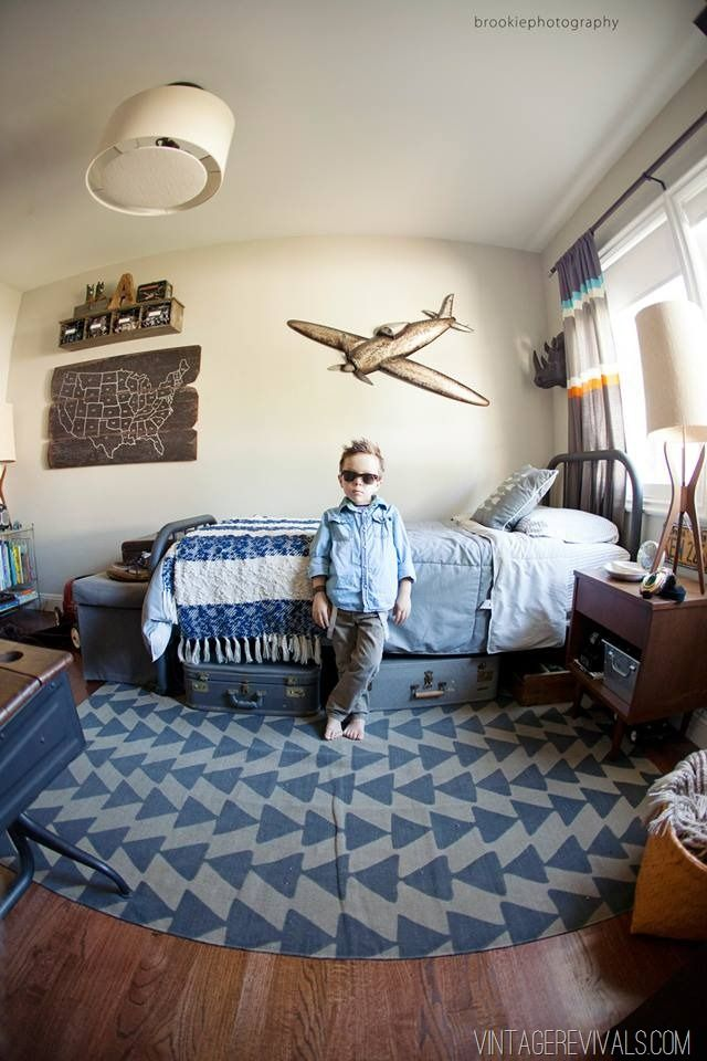 Vintage suitcases used as under bed storage!! (Pretty much love this whole room.)