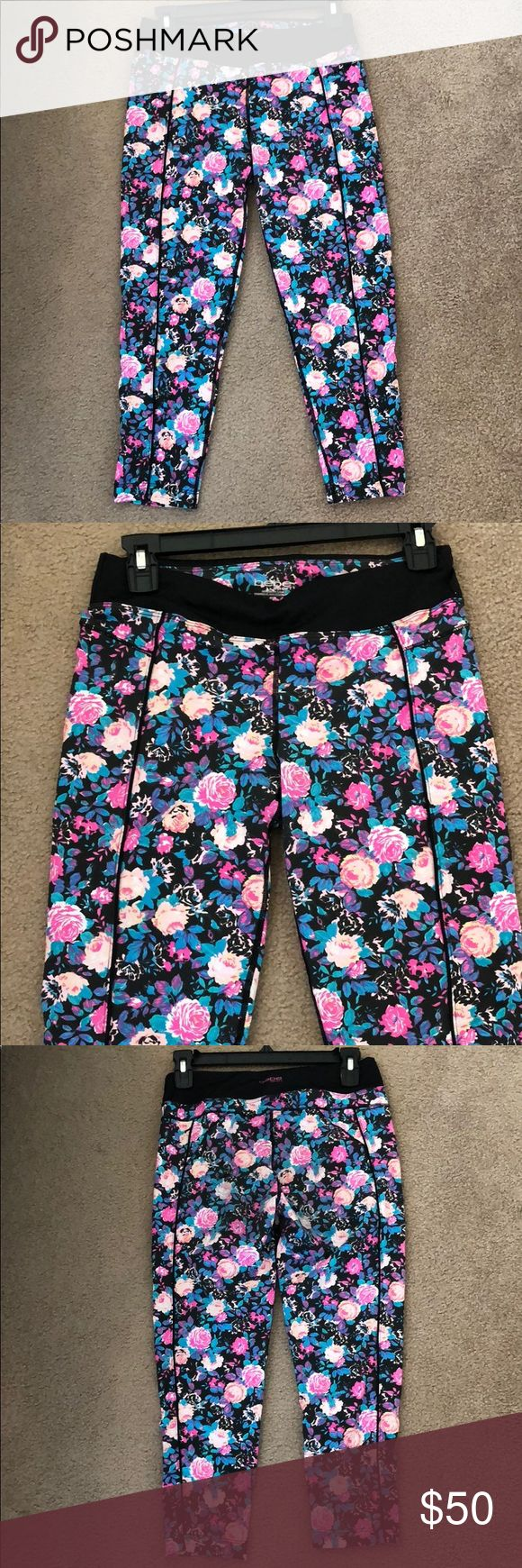 """Bebe Sport neon floral workout pant legging M Bebe Sport neon floral workout crop pant legging  Size Medium  Super cute bright floral print crops; black slimming seams down front and sides of legs.  Outer seam length: ~29.5"""" Inseam length: ~21.5""""  Worn once! Washed on delicate, hung dry  Sorry no trades  *pants only, sports bra not included. bebe Pants Ankle & Cropped"""