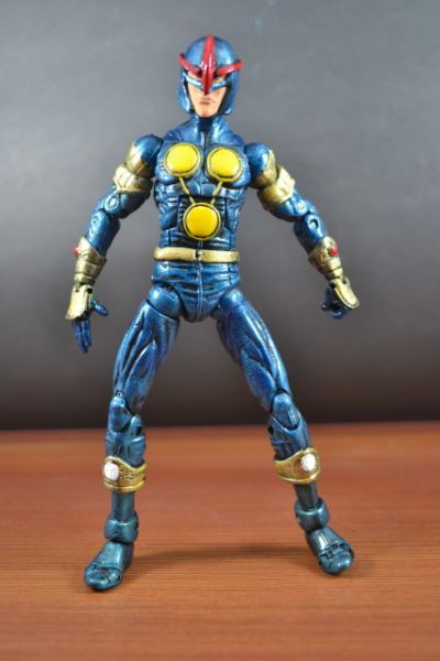 this is a marvel legends Nova (Sam Alexander ) Custom Action Figure he was made by figure realmer eddiegrayce's customs he used a wiccan body and street fighter remy head happy pinning