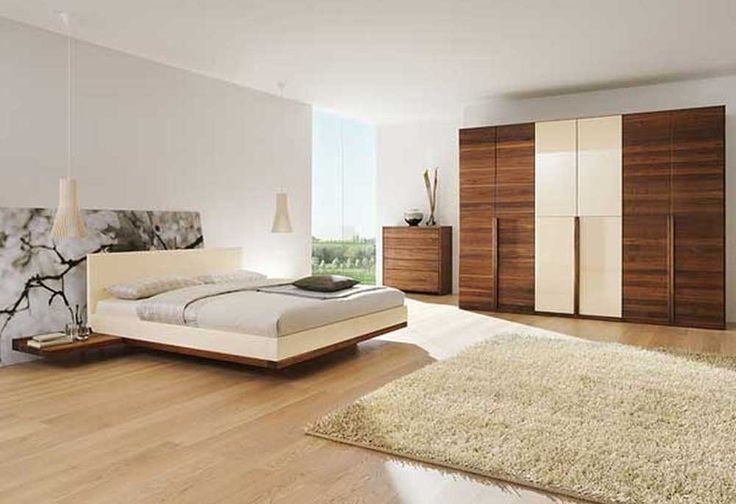 Large Modern Bedroom Cupboards with beige platform bed frame along soft gray bedding also twin white pendant lamp plus beige fur rug on the laminate wooden floor