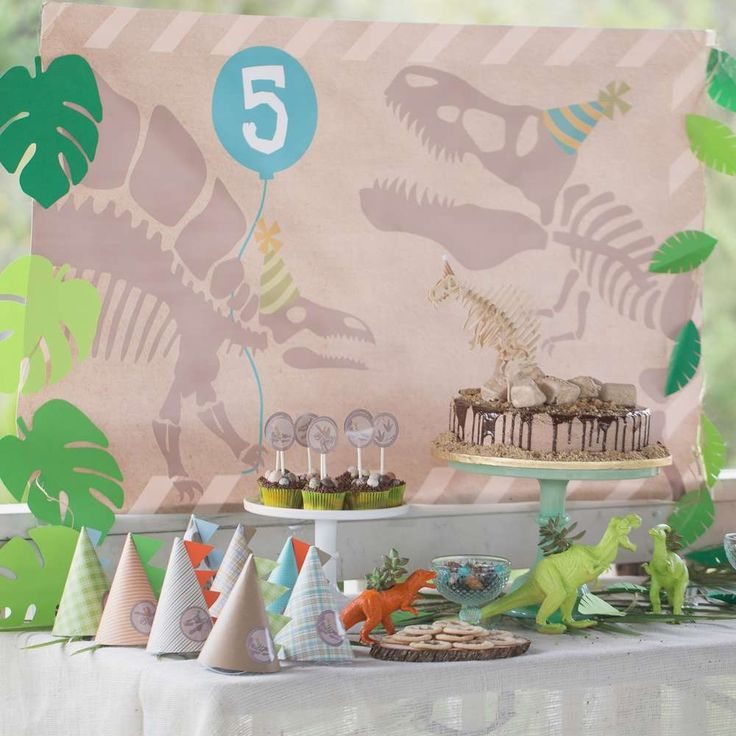 Fun dessert table at a dinosaur birthday party! See more party planning ideas at CatchMyParty.com!