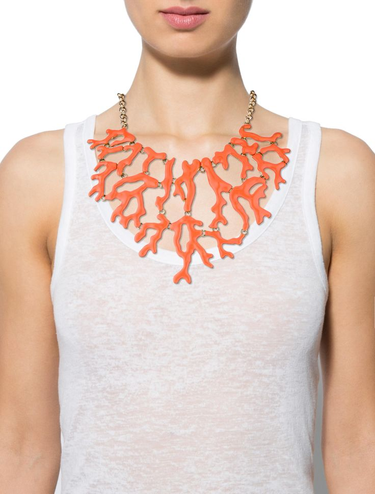 Gold-tone Kenneth Jay Lane Coral collar necklace featuring enamel details and fishhook closure.