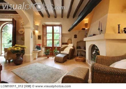 Spanish style living room with ceiling beams and fireplace for Spanish style interior shutters