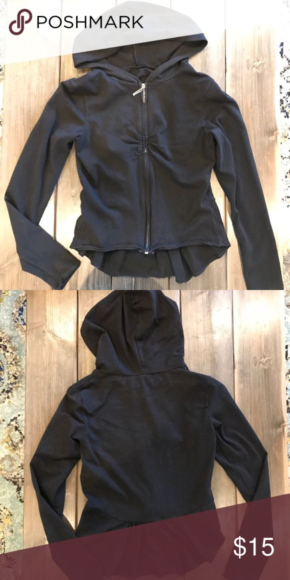 VS yoga small zip up black hoodie Cute black zip up hoodie from Victoria's Secret yoga with a wavy bottom of the back part. Gently worn only twice. No longer sold by VS. VS Yoga Sweaters