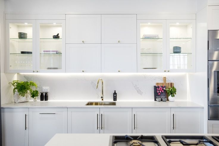 Oozing luxury and glamour, this kitchen is a modern take on the traditional Shaker style. Featuring stunning Gaggenau appliances throughout, Caesarstone Statuario Maximus benchtops and splashback and Shaker style cabinetry in matte white and black; this is a kitchen that demands attention.