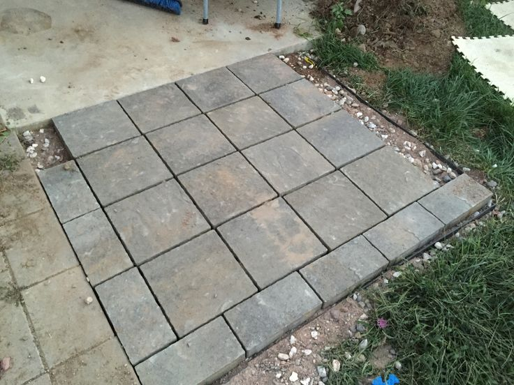 """The same area but almost """"finished"""" with only using paver sand and pavers. This has now eliminated the """"muddy mess"""" for some happy parents at very low cost."""