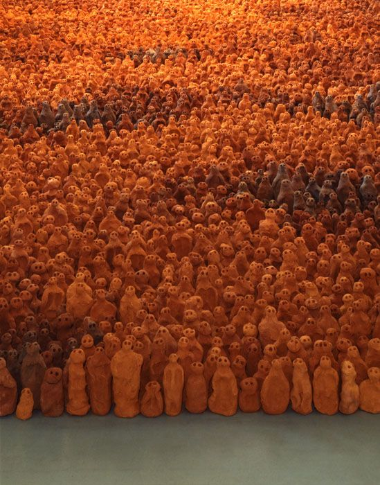 "This is Antony Gormley's work ""The Field"". it consist of 35,000 individual terracotta figures, installed on the floor facing towards the people that come in. they were made in Mexico by family bricklayers working with the artist himself, the art received a lot of media attention the day it was put up for display. Antony gormley has work a lot with clay but using other materials too like wire,wood and iron."