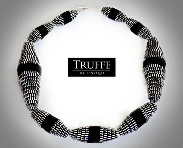 The original, hand-made necklace made of zippers and silver (925) high quality materials.
