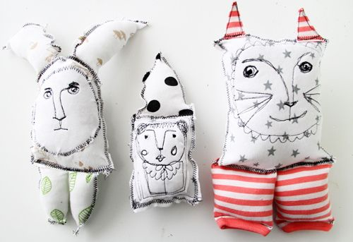 Upcycled baby-clothes creatures... (Alisa Burke) LOVE how deliciously awkward these fellows are!