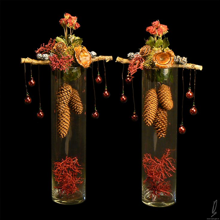 Very unusual, Christmas arrangement in clear cylindrical vase