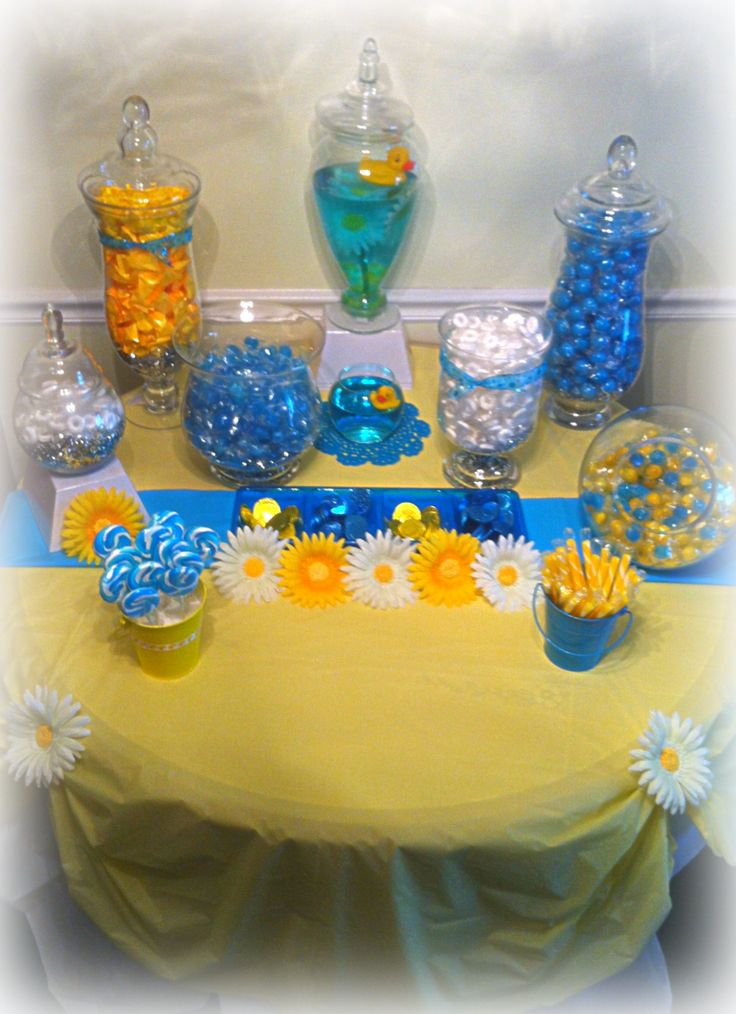 It's a boy! Caribbean blue and yellow, elegant, rubber ducky themed, baby shower decorations. Candy buffet display. All glass containers were purchased at TJ Maxx or Marshall's, and ranged in price from $6.99 to $12.99.