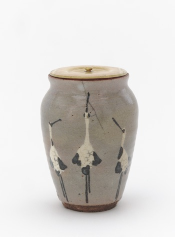 Kenzan-style powdered tea container with designs of standing cranes late 19th century Ogata Kenzan , (Japanese, 1663-1743) Meiji era Buff clay; white slip, iron pigment under transparent glaze, ivory lid. H: 8.2 W: 6.0 D: 6.0 cm Kyoto, Japan