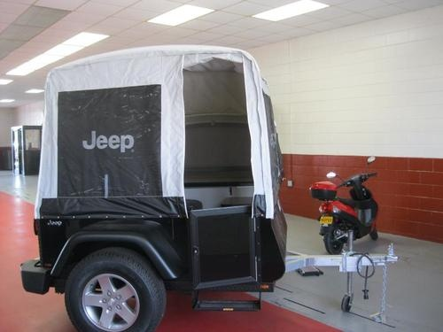 Brand New 2011 Jeep Mopar Trail Edition Pop-Up Camper ~ Off Road Trailer ~ 4x4 Tent. Available in two models, Trail and Extreme Trail, both accommodate four adults, feature a queen-size bed, sofa with storable table, built-in aluminum cabinet, 110-volt power supply and premium canvas enclosure. (Note: the photo here is not from the linked site but seems to show the trailer's size better.)