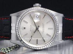 Rolex - Datejust 16234 Cassa: acciaio - 36 mm Ghiera: oro bianco Vetro: zaffiro Quadrante: argento - numeri arabi Bracciale: caucciu Chiusura: deployant Movimento: automatico