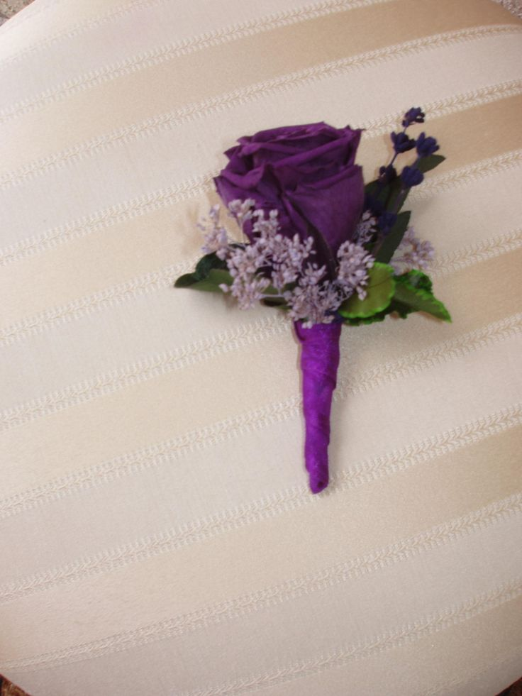 Purple? maybe silver boutonniere