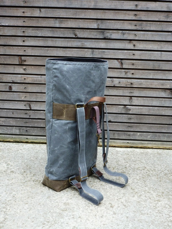 Waxed canvas rucksack/backpack with roll up top and double waxed bottem COLLECTION UNISEX. $169.00, via Etsy.