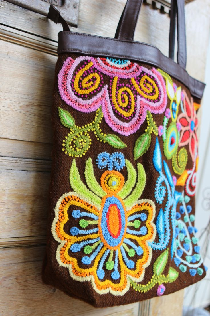 Threads of Hope handmade purse of wool and leather. www.threadsofhopetextiles.org